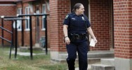 In this Friday, Oct. 31, 2014 photo, High Point Police Officer B. Williamson tries to serve a domestic violence prevention notification to an offender, in High Point, N.C. (AP Photo/Lynn Hey) (The Associated Press)