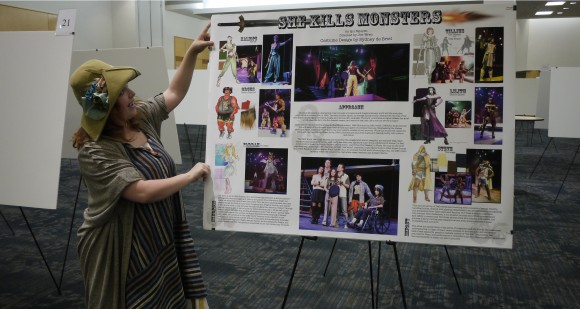 Sydney de Briel (Theatre) shows off her poster (source: The Graduate School)