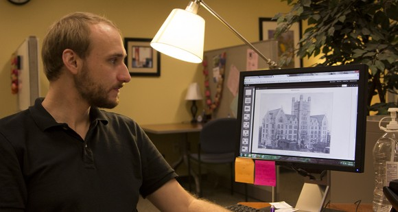 Grad student Carl Schlachte examines images from the NYC Municipal Archives