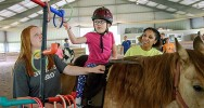 A Horsepower Experience camper works her way through an obstacle course.