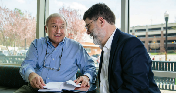 Link (left) and Associate Professor of Economics Dennis Leyden discuss ways to incorporate analyses from their new book, Public Sector Entrepreneurship (Oxford University Press, 2015), into graduate courses in the economics department.