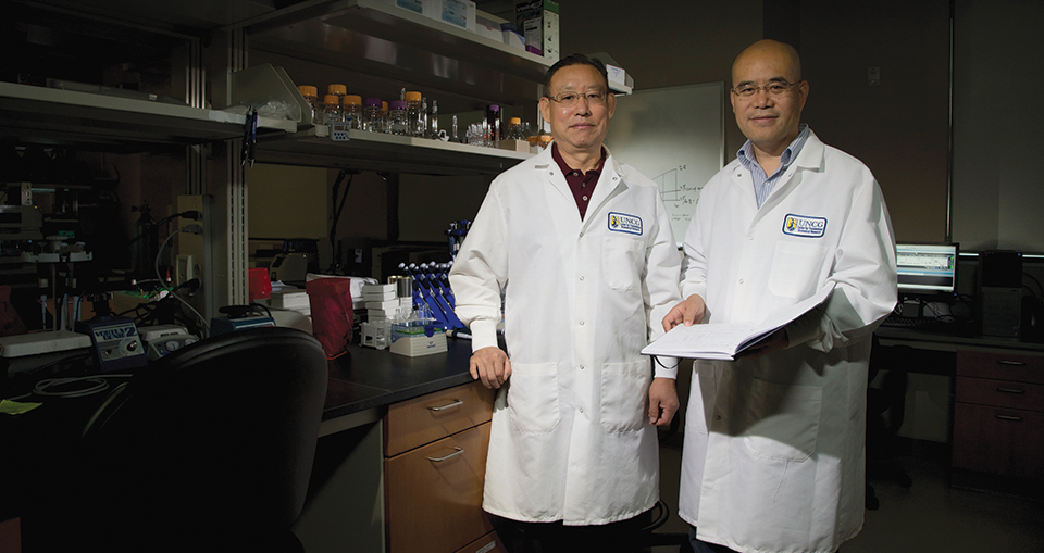 Dr. Zhanxiang Zhou and Dr. Qibin Zhang at the Center for Translational Biomedical Research