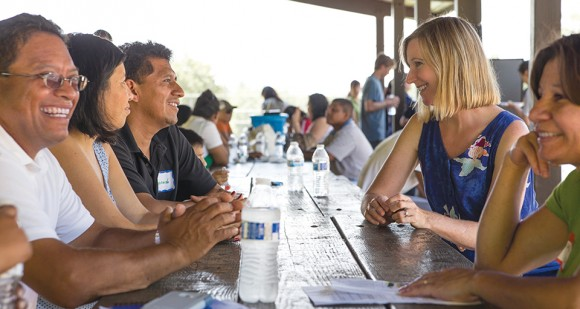 This August, Gonzalez (right) kicked off the third year of Padres Promoviendo Preparación with a community picnic for program participants, their families, and friends. Local universities sent representatives to the event to share information about higher ed opportunities. (Photo by Jenna Schad.)