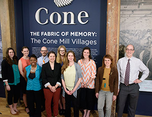 From left to right: UNCG graduate students Libby Clark, Amanda Holland, Candace Cook, Jason Baum, Courtney Little, Crystal Kulhanek, Katie DeMar-Aldrich, Jessica Bierman and Kimber Heinz and UNCG Director of Public History Dr. Benjamin Filene. [Photography by Martin W. Kane]