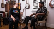 At home in her music room, Edwards talks with local bluesman Roy Roberts. [Photo by Mike Dickens]