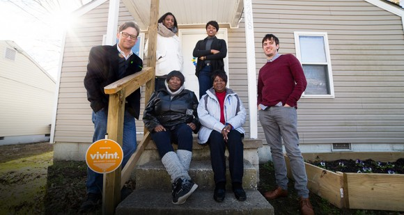 University and community partners gather at Collaborative Cottage Grove's house-turned-community-center. Clockwise from left: CHCS's Dr. Stephen Sills, Greensboro Housing Coalition's Josie Williams, undergraduate researcher Francheska Elliott, former undergraduate researcher and current CHCS staff Phillip Sheldon, and community activists Sandra Williams and Verna Torain [Photo by Mike Dickens]
