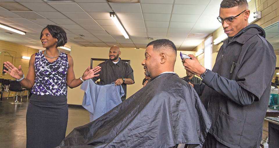 Coakley visits Prestige Barber College, owned by Gene Blackmon, one of Coakley's study partners.