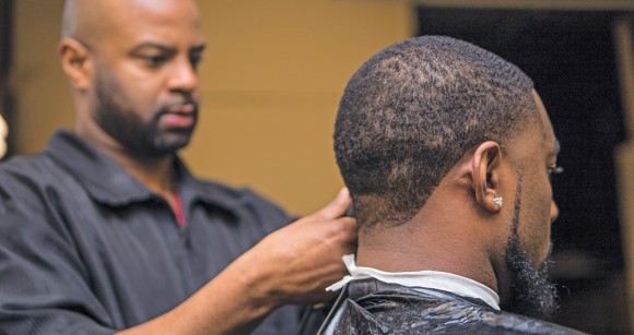 Gene Blackmon (left), owner of Prestige Barber College, is one of Coakley's study partners.
